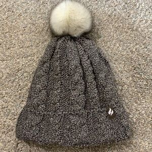Heat holder lined winter hat with Pom